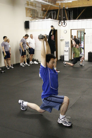 Crossfit.clarence.db.overhead.walking.lunge-761707